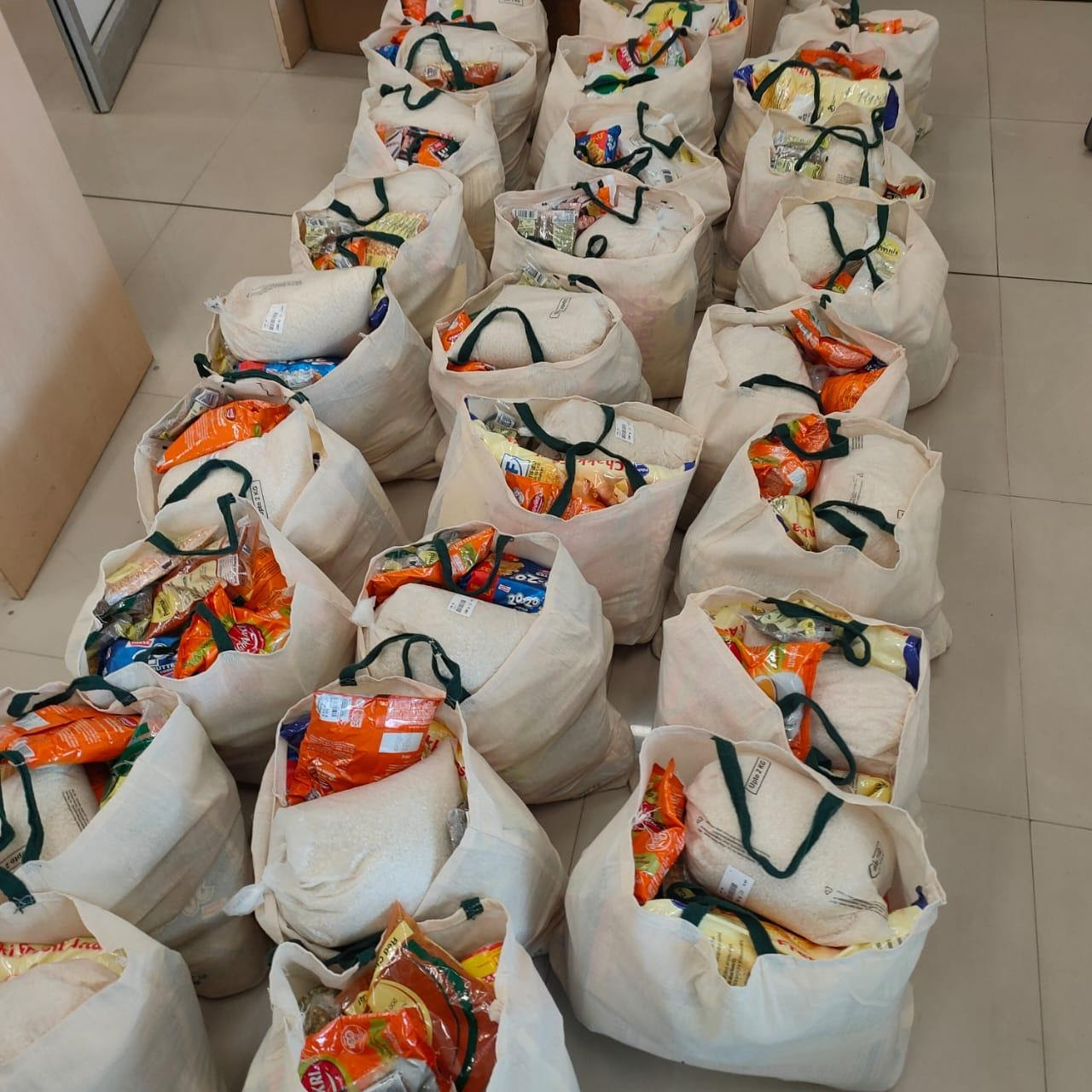 Food packets ready to be delivered to underprivileged families in Vapi, Gujarat