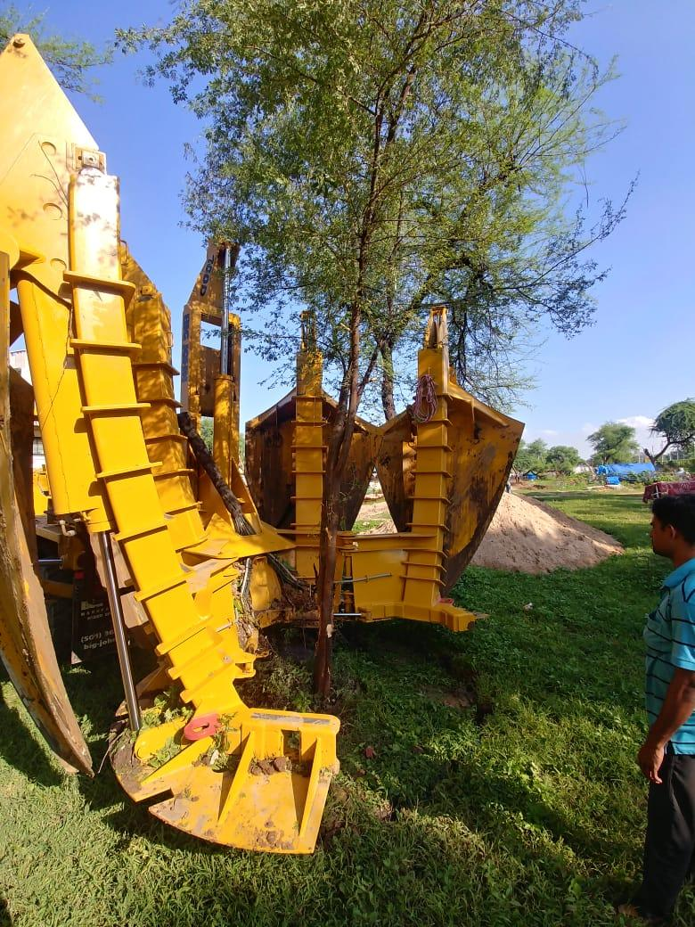 Tree Spade transplanting trees in Ahmedabad area